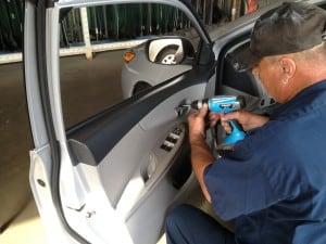 A man Repairing Power Window